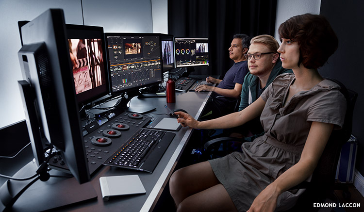 An international group of colourists work at various color grading workstations